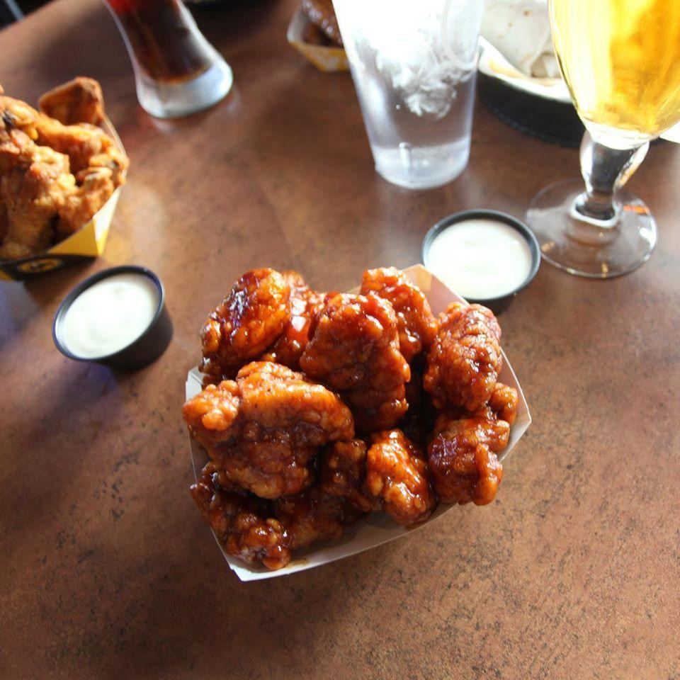 """<p>Shocker: The wings at Buffalo Wild Wings are pretty popular. There are plenty of ways you can go from there with your choice, though. First, bone-in or boneless? It's a close call, but traditional wings <a href=""""https://www.cnbc.com/id/45884538"""" rel=""""nofollow noopener"""" target=""""_blank"""" data-ylk=""""slk:just slightly edge out"""" class=""""link rapid-noclick-resp"""">just slightly edge out</a> boneless. Then, what sauce to choose? <a href=""""https://www.cnbc.com/id/45884538"""" rel=""""nofollow noopener"""" target=""""_blank"""" data-ylk=""""slk:According to the company's marketing team"""" class=""""link rapid-noclick-resp"""">According to the company's marketing team</a>, Honey BBQ takes the prize. Medium heat comes in second, followed by a tie between Spicy Garlic, Asian Zing, and Parmesan Garlic.</p>"""