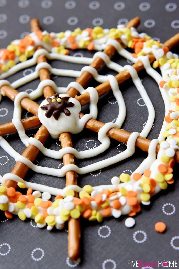 """<p>How creative are these """"spiderwebs""""? They're made with a simple combination of pretzels, chocolate, and sprinkles. </p><p><strong>Get the recipe at <a href=""""http://www.fivehearthome.com/2014/09/25/pretzel-candy-spiderwebs-for-halloween/"""" rel=""""nofollow noopener"""" target=""""_blank"""" data-ylk=""""slk:Five Heart Home"""" class=""""link rapid-noclick-resp"""">Five Heart Home</a></strong>.</p><p><strong><a class=""""link rapid-noclick-resp"""" href=""""https://go.redirectingat.com?id=74968X1596630&url=https%3A%2F%2Fwww.walmart.com%2Fip%2FThe-Pioneer-Woman-Vintage-Floral-14-5-Inch-Serving-Platter%2F147105294&sref=https%3A%2F%2Fwww.thepioneerwoman.com%2Ffood-cooking%2Fmeals-menus%2Fg32110899%2Fbest-halloween-desserts%2F"""" rel=""""nofollow noopener"""" target=""""_blank"""" data-ylk=""""slk:SHOP SERVING PLATTERS"""">SHOP SERVING PLATTERS </a></strong> </p>"""