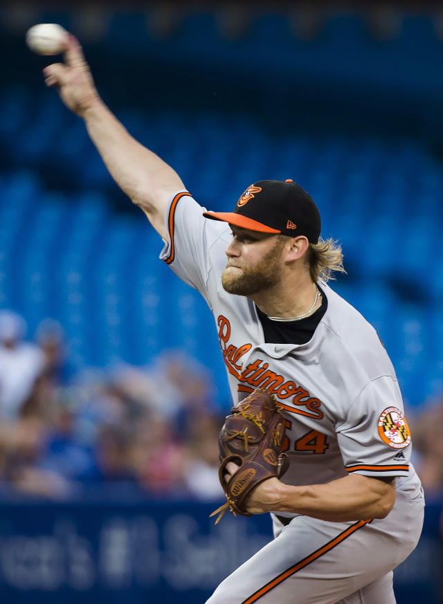 Baltimore Orioles starting pitcher Andrew Cashner works against the Toronto Blue Jays during first-inning baseball game action in Toronto, Monday, Aug. 20, 2018. (Nathan Denette/The Canadian Press via AP)