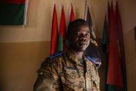 """Etienne Bonkoungou, a pastor and military chaplain, stands for a portrait at the 10th RCAS army barracks in Kaya, Burkina Faso, Saturday, April 10, 2021. Bonkoungou says he regularly counsels troops grappling with the question of whether their participation in the fight makes them defenders or killers. """"The Bible says not to kill, so as a soldier these questions often arise. ... To kill another, to watch a colleague die (or kill someone yourself), should you kill? Should you not kill?"""" (AP Photo/Sophie Garcia)"""