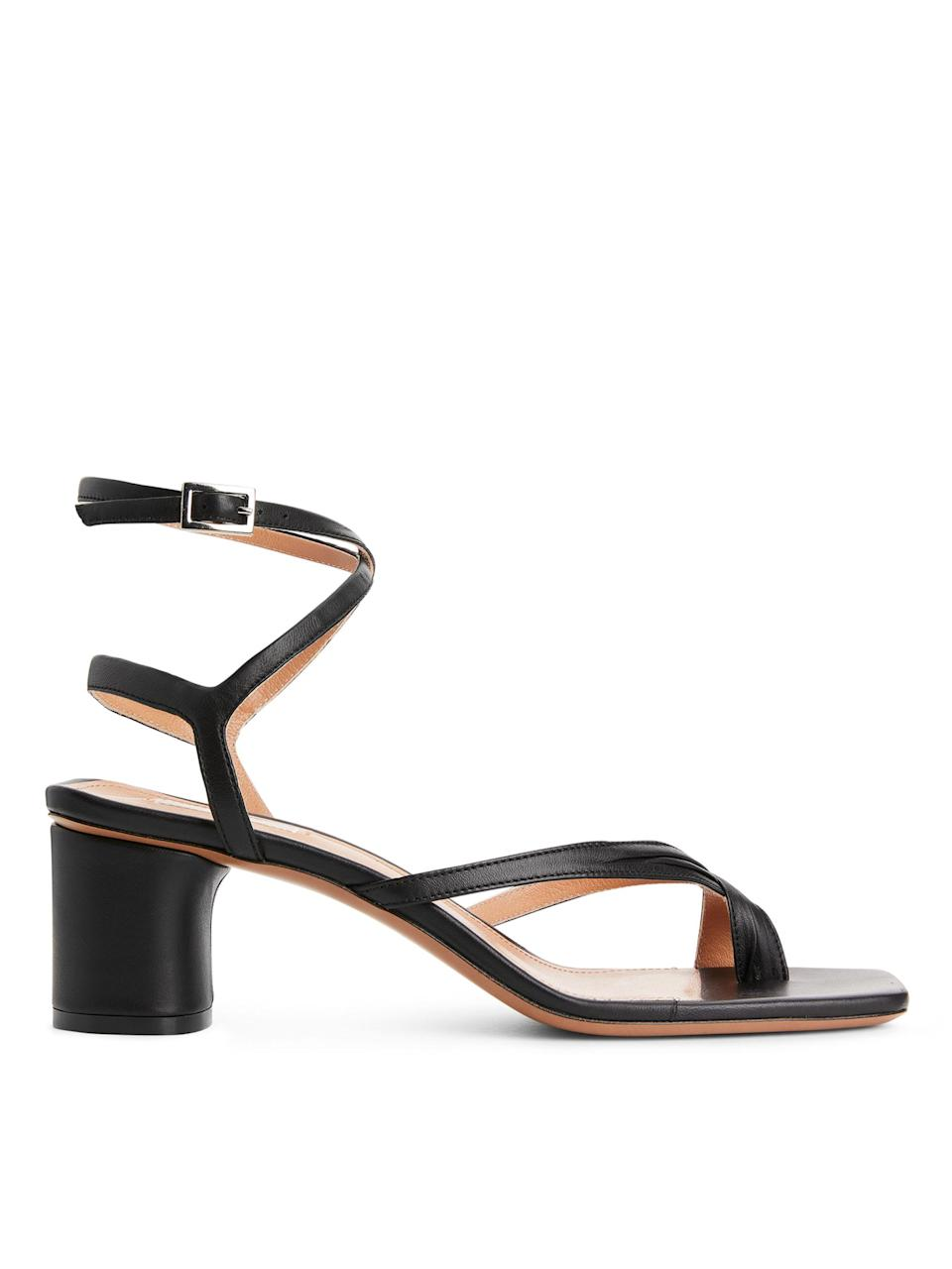 "<p><span>We all need a do-all black sandal to see us through summer, so why not put your money to a gorgoeus leather pair that will look good with anything? Hey, like these. </span><br><em><a href=""https://www.arket.com/en_gbp/women/shoes/product.ankle-wrap-leather-sandal-black.0650566001.html"" rel=""nofollow noopener"" target=""_blank"" data-ylk=""slk:Buy here."" class=""link rapid-noclick-resp""><span>Buy here.</span></a></em> </p>"