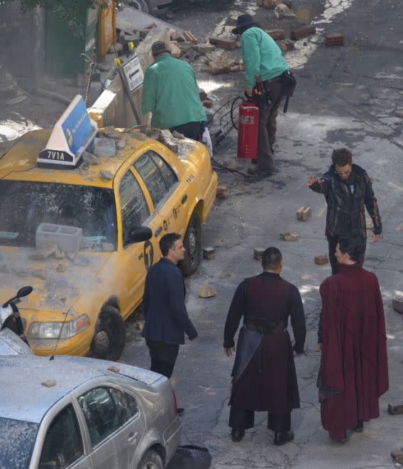 "<p>Cast members Mark Ruffalo, from left, Benedict Wong, Robert Downey Jr., and Benedict Cumberbatch, foreground left, await their scene during the filming of ""Avengers: Infinity War,"" on Monday, June 26, 2017, in Atlanta. Scenes from the film, expected in May 2018, are being shot Monday on a street in downtown Atlanta. (AP Photo/Mike Stewart) </p>"