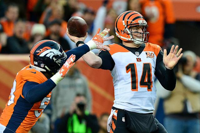 <p>Quarterback Andy Dalton #14 of the Cincinnati Bengals passes under pressure by outside linebacker Von Miller #58 of the Denver Broncos at Sports Authority Field at Mile High on November 19, 2017 in Denver, Colorado. (Photo by Dustin Bradford/Getty Images) </p>