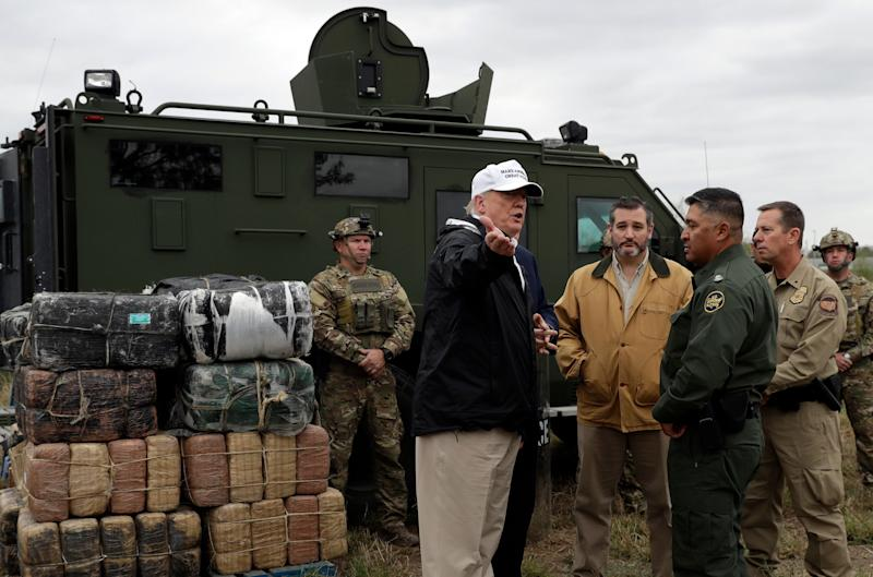 President Donald Trump tours the U.S. border with Mexico at the Rio Grande on the southern border, Thursday, Jan. 10, 2019, in McAllen, Texas. [AP Photo/ Evan Vucci)