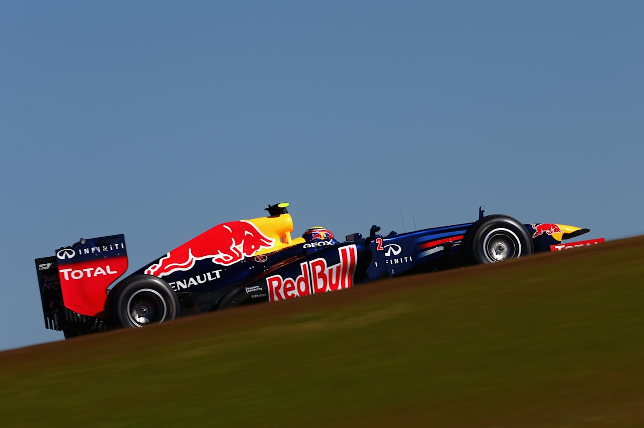AUSTIN, TX - NOVEMBER 17:  Mark Webber of Australia and Red Bull Racing drives during qualifying for the United States Formula One Grand Prix at the Circuit of the Americas on November 17, 2012 in Austin, Texas.  (Photo by Clive Mason/Getty Images)