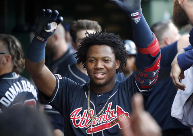 Atlanta Braves' Ronald Acuna Jr. celebrates his home run off Chicago Cubs starting pitcher Adbert Alzolay during the first inning of a baseball game, Tuesday, June 25, 2019, in Chicago. (AP Photo/Charles Rex Arbogast)