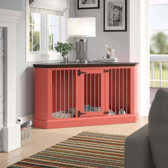 """This solid wood triangle-shaped crate works perfectly as a private spot for your dog as well as a table to enhance awkward corners. It can come in more than two dozen different base colors, as well as three top finishes, so it won't be hard finding the right hue to match the rest of your furniture. $1080, Wayfair. <a href=""""https://www.wayfair.com/pet/pdp/archie-oscar-brooke-medium-corner-credenza-pet-crate-aosc1398.html"""" rel=""""nofollow noopener"""" target=""""_blank"""" data-ylk=""""slk:Get it now!"""" class=""""link rapid-noclick-resp"""">Get it now!</a>"""