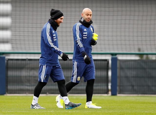 Soccer Football - Argentina Training - City Football Academy, Manchester, Britain - March 20, 2018 Argentina's Lionel Messi and Javier Mascherano during training Action Images via Reuters/Jason Cairnduff