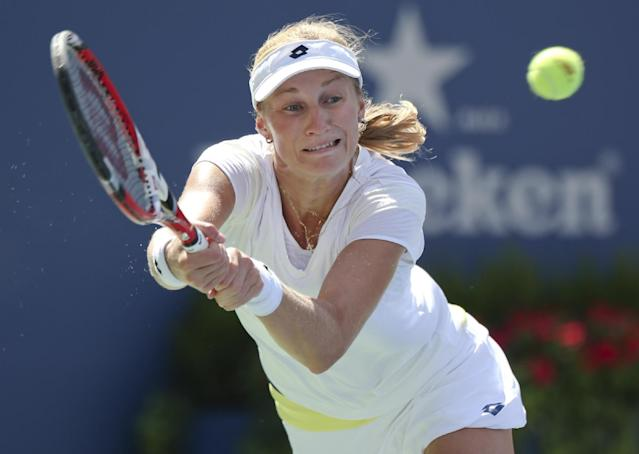 Ekaterina Makarova, of Russia, returns a shot against Victoria Azarenka, of Belarus, during the quarterfinals of the 2014 U.S. Open tennis tournament, Wednesday, Sept. 3, 2014, in New York. (AP Photo/Mike Groll)