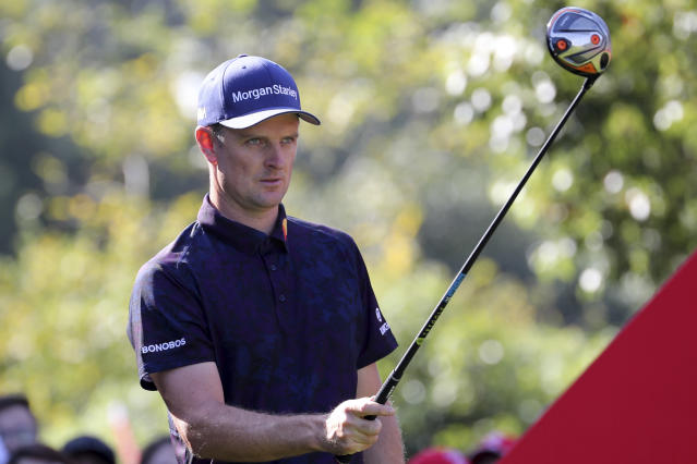 Justin Rose of England lines up his shot for the HSBC Champions golf tournament held at the Sheshan International Golf Club in Shanghai on Friday, Nov. 1, 2019. (AP Photo/Ng Han Guan)