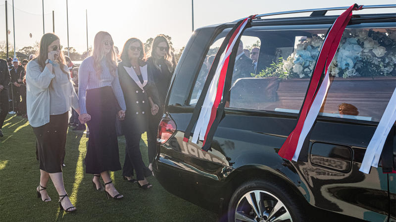 The Hearse carrying the coffin of Danny Frawley does a lap of honour and followed by his wife and daughters during the Danny Frawley Funeral Service on September 18, 2019 in Melbourne, Australia. (Photo by Asanka Ratnayake/Getty Images)