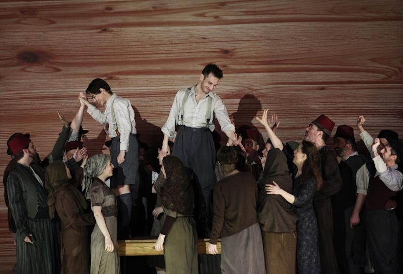 """In this April 15, 2013 photo provided by the Brooklyn Academy of Music countertenor Pascal Charbonneau, upper right, performs the role of David with soprano Ana Quintans, upper left, in the role of Jonathas as the rest of the cast gathers below them during a final dress rehearsal of Charpentier's opera """"David et Jonathas,"""" at the Brooklyn Academy of Music, in New York. (AP Photo/Brooklyn Academy of Music, Julieta Cervantes)"""