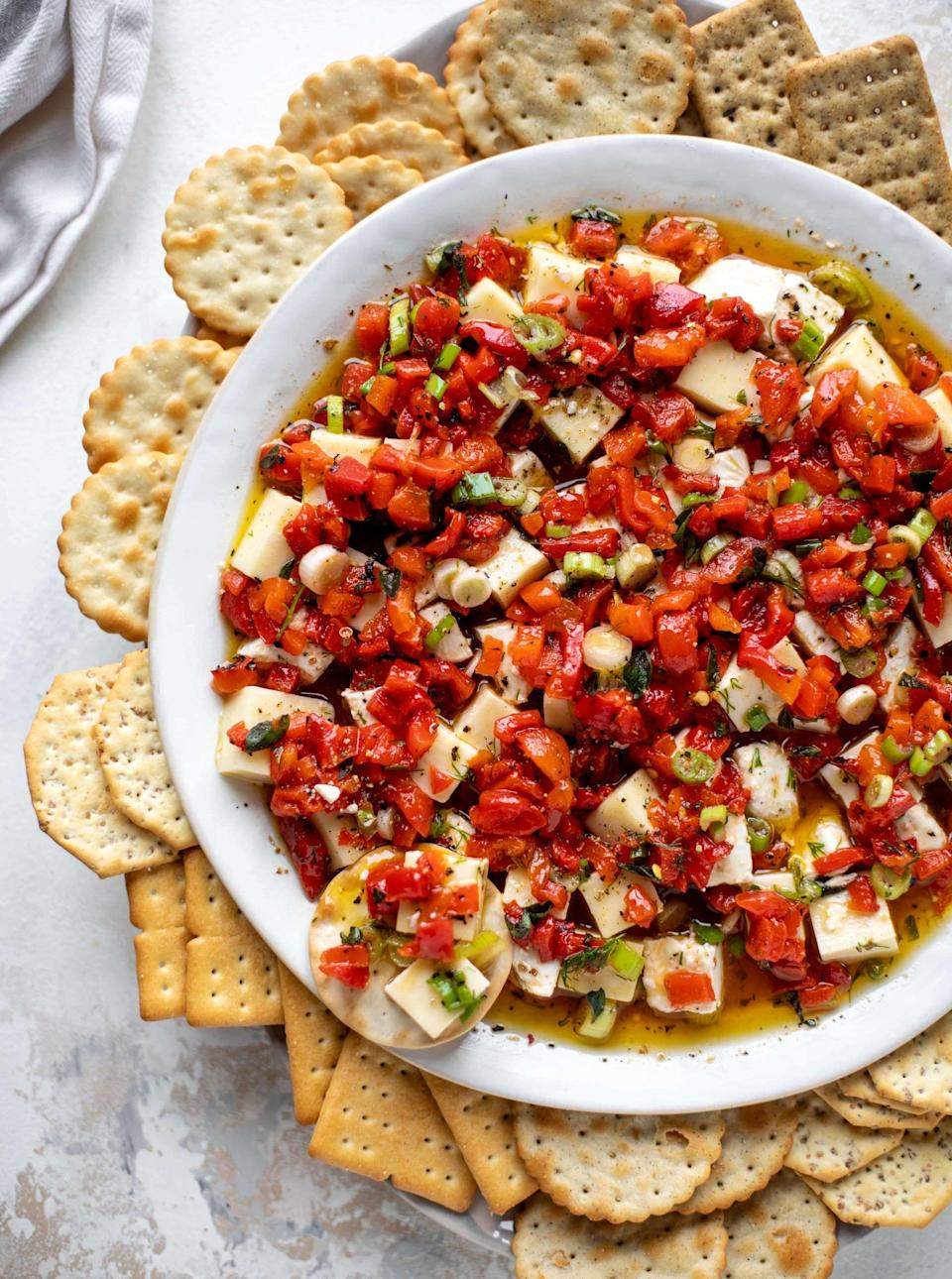 """<p>This marinated cheese recipe is a game day favorite, and for good reason! Load up on the crackers, and dive into this dip anytime you're in the mood for some seriously good cheese.</p> <p><strong>Get the recipe:</strong> <a href=""""https://www.howsweeteats.com/2019/12/marinated-cheese/"""" class=""""link rapid-noclick-resp"""" rel=""""nofollow noopener"""" target=""""_blank"""" data-ylk=""""slk:marinated cheese"""">marinated cheese</a></p>"""