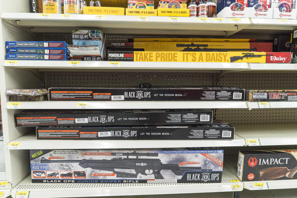 A variety of rifles seen packed on store shelves.