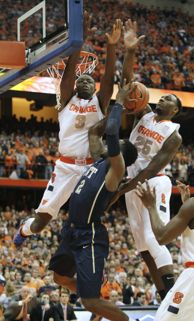 Syracuse's Jerami Grant (3) and Rakeem Christmas (26) put pressure on Pittsburgh's Michael Young in the first half of an NCAA college basketball game in Syracuse, N.Y., Saturday, Jan. 18, 2014. (AP Photo/Nick Lisi)