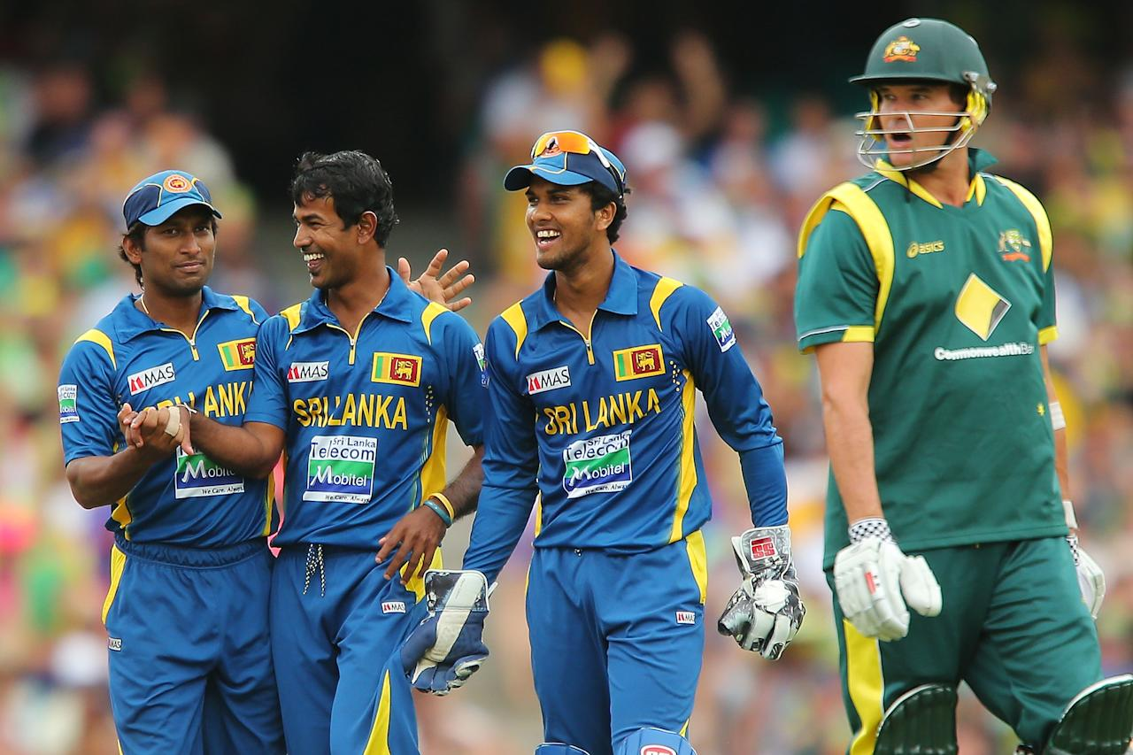 SYDNEY, AUSTRALIA - JANUARY 20:  Nuwan Kulasekara of Sri Lanka celebrates with team mates after claiming the wicket of Clint McKay of Australia during game four of the Commonwealth Bank one day international series between Australia and Sri Lanka at Sydney Cricket Ground on January 20, 2013 in Sydney, Australia.  (Photo by Brendon Thorne/Getty Images)