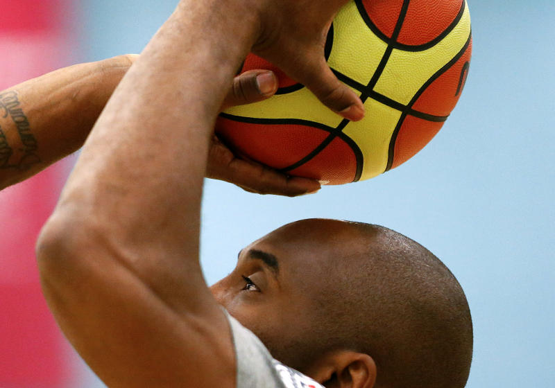United States guard Kobe Bryant shoots during a men's basketball team practice at the 2012 Summer Olympics, Saturday, July 28, 2012, in London. (AP Photo/Jae C. Hong)