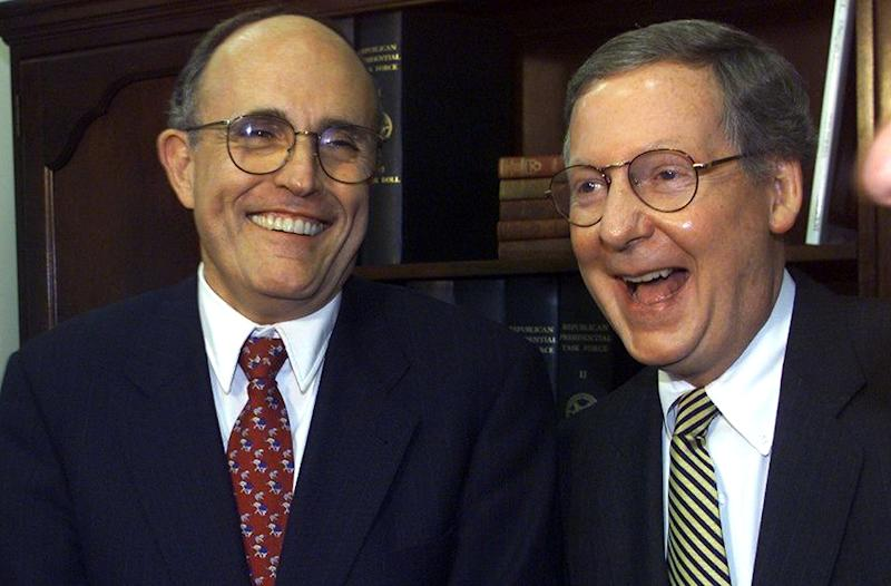 Rudy Giuliani and Senate Majority Leader Mitch McConnell at a Republican party fundraiser in 1999.
