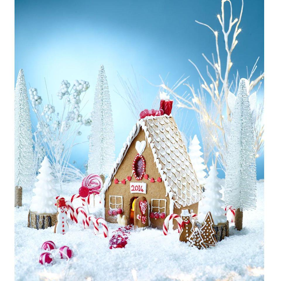 """<p>Follow our recipe to create your very own Winter Wonderland gingerbread house, a great activity to do with the kids.</p><p><strong><br>Recipe: <a href=""""https://www.goodhousekeeping.com/uk/christmas/christmas-recipes/a551361/winter-wonderland-gingerbread-house/"""" rel=""""nofollow noopener"""" target=""""_blank"""" data-ylk=""""slk:Winter Wonderland Gingerbread House"""" class=""""link rapid-noclick-resp"""">Winter Wonderland Gingerbread House</a></strong></p>"""
