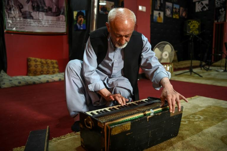 Poet Safiullah Sobat shows the old harmonium that belonged to Afghanistan's Elvis Presley, at the Ahmad Zahir Cultural Centre in Kabul