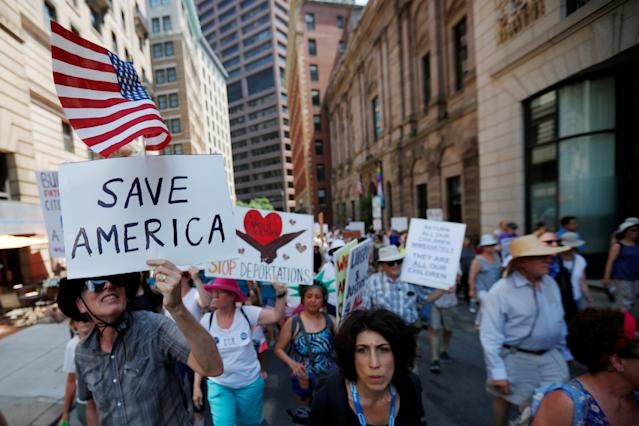 "<p>Demonstrators carrying signs, including one reading ""Save America"", march during the ""Families Belong Together"" rally in Boston, Mass., June 30, 2018 (Photo: Brian Snyder/Reuters) </p>"
