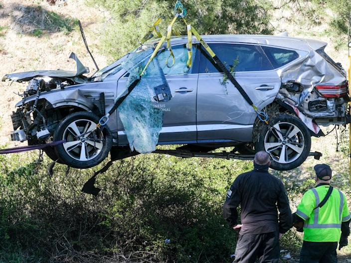 <p>Investigators recover the vehicle of Tiger Woods following 23 February crash</p> (AP)