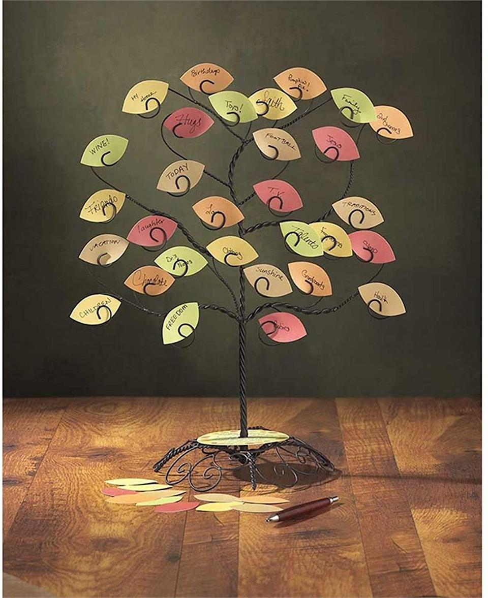 "<p>If you'd rather buy than DIY, this centerpiece figurine is the perfect thankful tree to display on your shelf or mantel, and includes the colorful paper leaves so you and your family can write down what you're thankful for. The best part is that you can replace the leaves with family photos after Thanksgiving is over, making it the perfect year-round decor piece for your home!</p><p><a class=""link rapid-noclick-resp"" href=""https://www.amazon.com/Jozie-Thankful-Display-Centerpiece-Figurine/dp/B00NETFISI/ref=sr_1_2?dchild=1&keywords=thankful+tree&qid=1596726436&sr=8-2&tag=syn-yahoo-20&ascsubtag=%5Bartid%7C10055.g.33525114%5Bsrc%7Cyahoo-us"" rel=""nofollow noopener"" target=""_blank"" data-ylk=""slk:BUY NOW ON AMAZON"">BUY NOW ON AMAZON</a></p>"