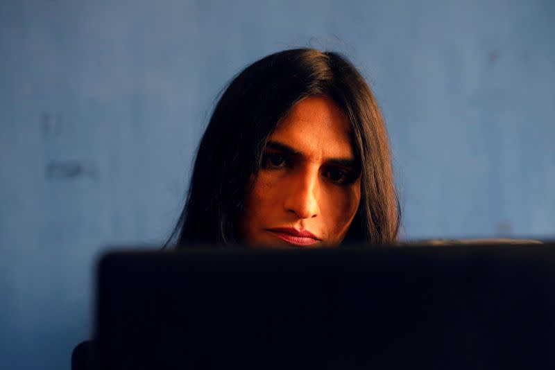Nisha Rao, 28, a transgender woman who became country's first practicing lawyer, works at her office in Karachi,