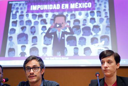 """Mexican actor Gael Garcia Bernal (L) attends a side event on """"Combatting atrocity, crimes, corruption and impunity in Mexico"""" next to Isabelle Gattiker Director of the FIFDH during the Human Rights Council at the United Nations in Geneva, Switzerland, March 13, 2018. REUTERS/Denis Balibouse"""