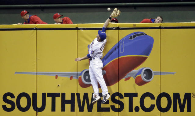 Milwaukee Brewers' Logan Schafer can't catch a two-run home run hit by Philadelphia Phillies' Jimmy Rollins during the sixth inning of a baseball game Wednesday, July 9, 2014, in Milwaukee. (AP Photo/Morry Gash)