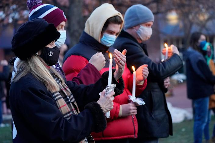 Mourners gather for a vigil for the victims of a mass shooting at a grocery store in Boulder, Colo.