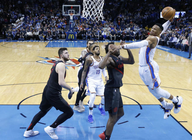 Thunder star Russell Westbrook goes up for a dunk against Blazers forward Al-Farouq Aminu in the second half. (AP)