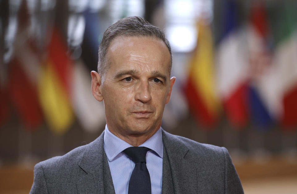 German Foreign Minister Heiko Maas speaks with the media as he arrives for a meeting of EU foreign ministers at the European Council building in Brussels, Monday, May 10, 2021. EU Foreign Affairs Ministers meet in Brussels to discuss current affairs, tensions with Russia, the Western Balkans, transatlantic relations and Belarus. (AP Photo/Olivier Matthys, Pool)