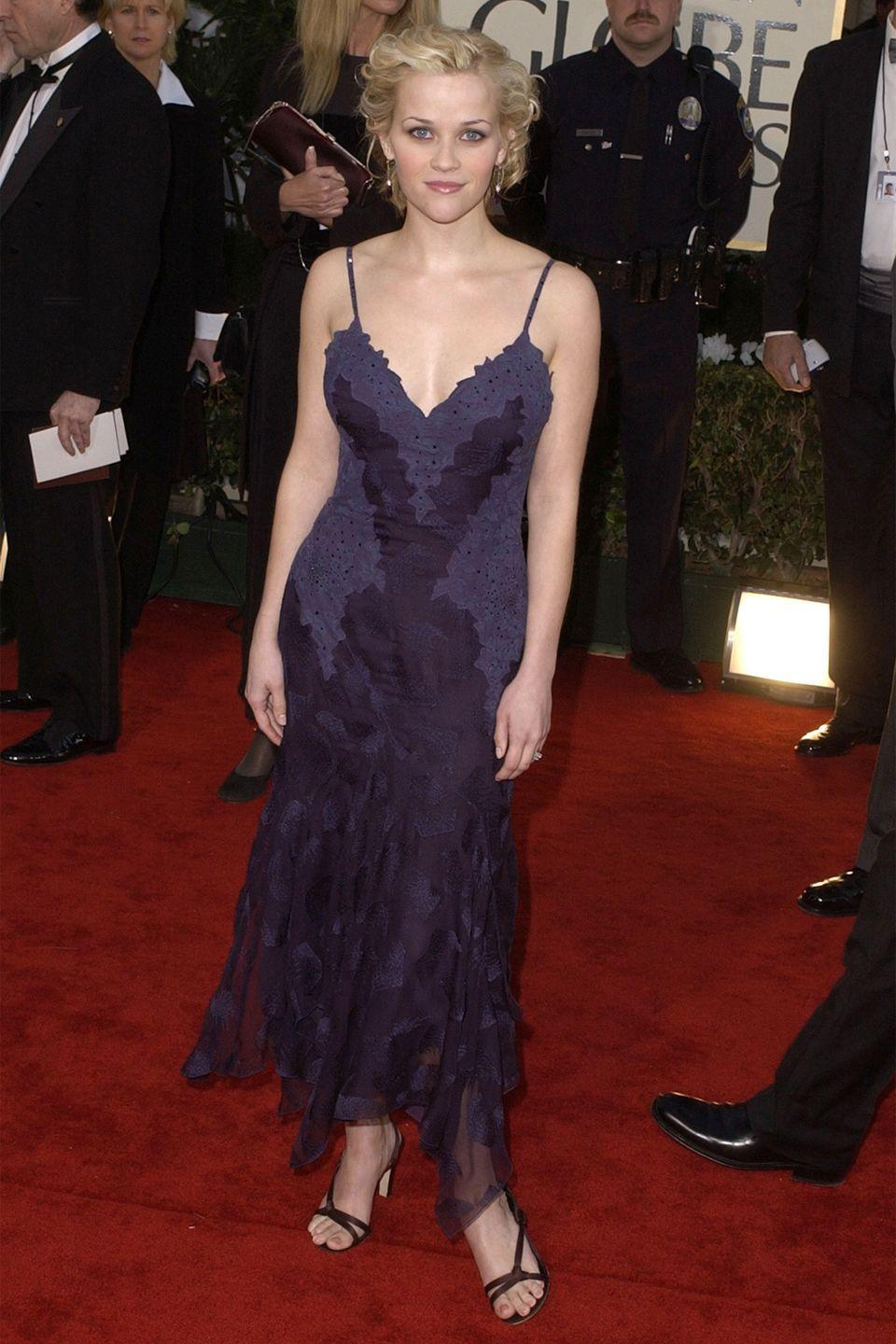 <p>At the Academy Awards, Witherspoon brought an old-Hollywood vibe in an embellished black gown with delicate lace cap sleeves. </p>