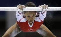 USA's Gabrielle Douglas, 16, performs on the uneven bars during the women's team final at the Artistic Gymnastics World Championships in Tokyo, Japan, Tuesday, Oct. 11, 2011. (AP Photo/Bullit Marquez)