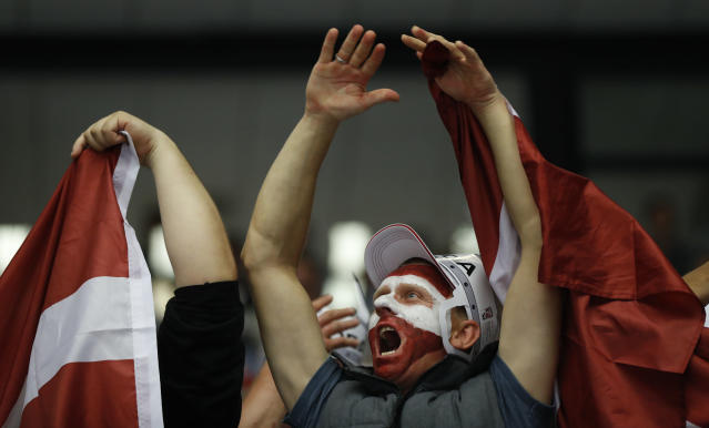 Fans of Latvia celebrate a goal during the Ice Hockey World Championships group B match between Denmark and Latvia at the Jyske Bank Boxen arena in Herning, Denmark, Tuesday, May 15, 2018. (AP Photo/Petr David Josek)