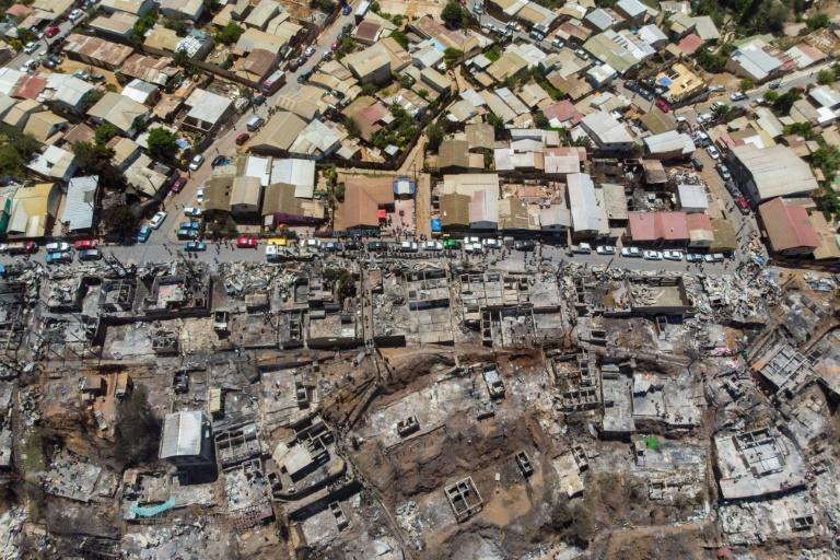An aerial view of burned houses after a forest fire at the Rocuant hill in Valparaiso, Chile, on December 25, 2019