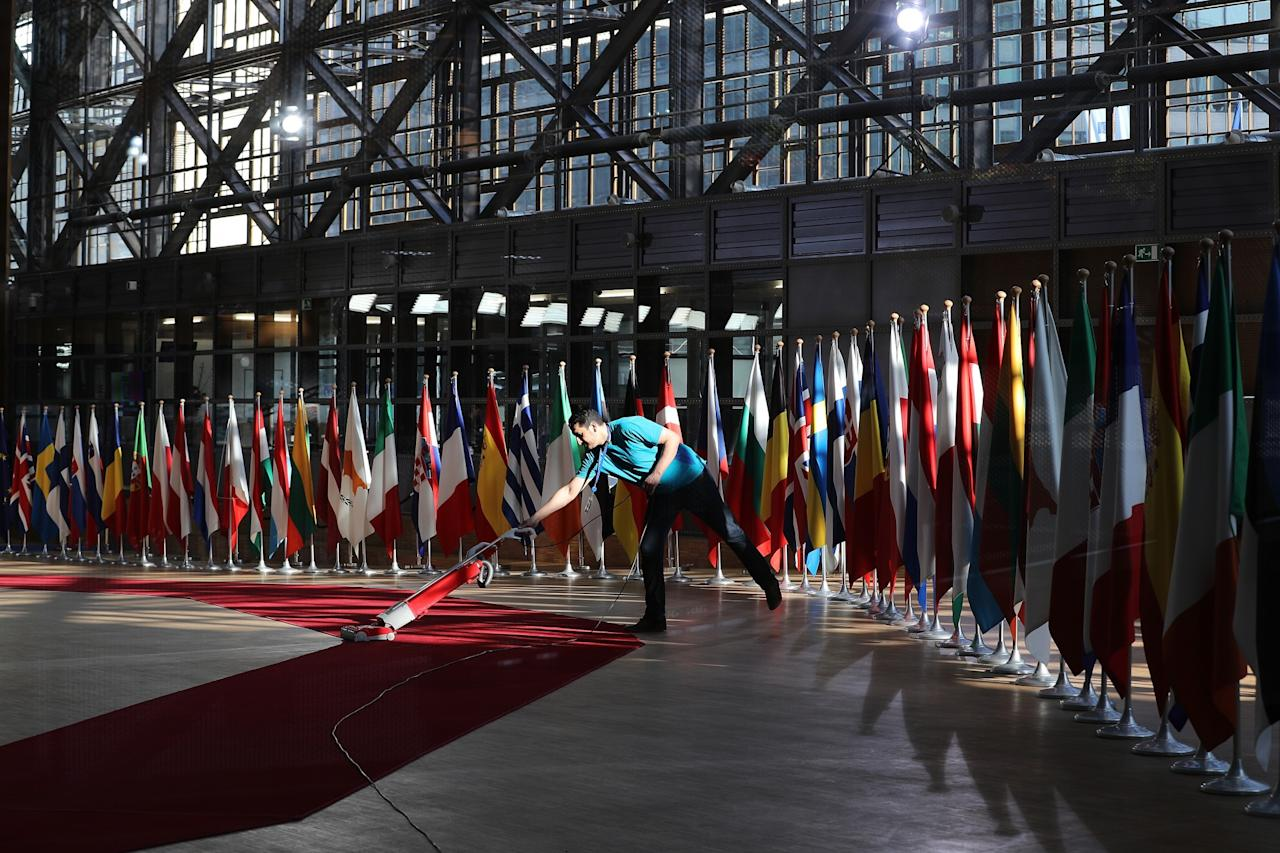 <p>The red carpet is swept at the Council of the European Union ahead of an EU Council meeting in Brussels to discuss the continuing Brexit negotiations. (Photo by Dan Kitwood/Getty Images) </p>