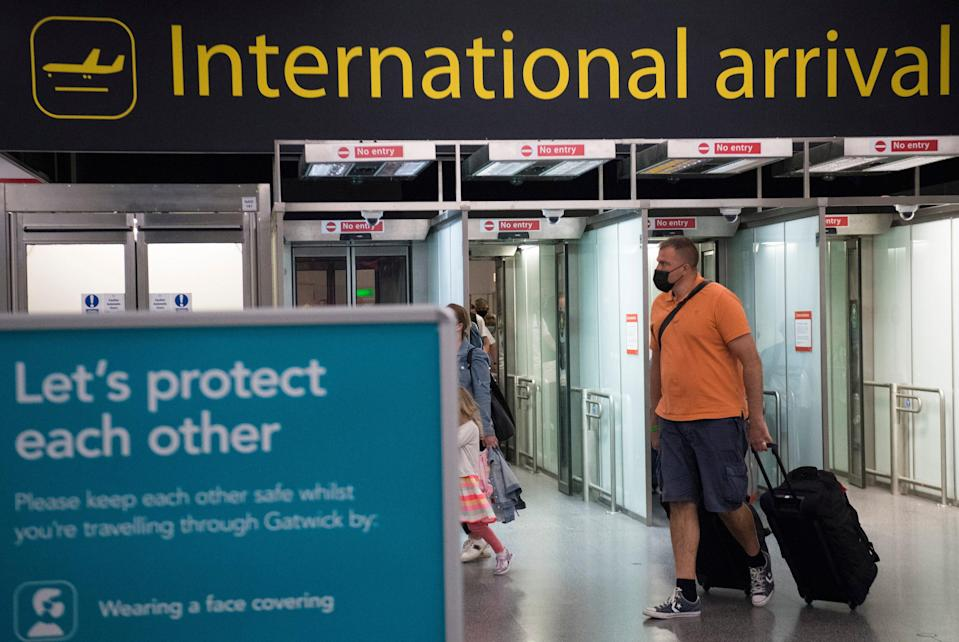 Gatwick Airport has many flights to amber list destinations (PA)