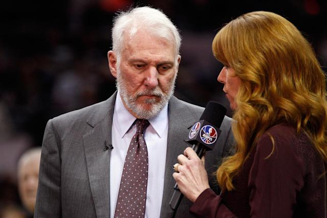 ESPNs Heather Cox (right) interviews Gregg Popovich during a game against the Clippers. (Soobum Im-USA TODAY Sports)