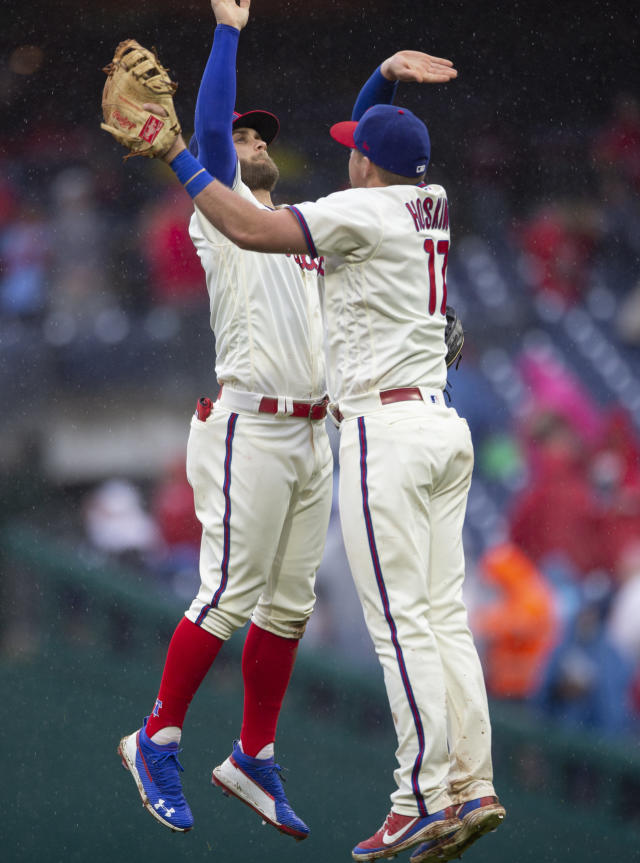 Philadelphia Phillies' Bryce Harper (3) and Rhys Hoskins (17) celebrate after their team defeated the Washington Nationals in a baseball game, Sunday, May 5, 2019, in Philadelphia. (AP Photo/Laurence Kesterson)