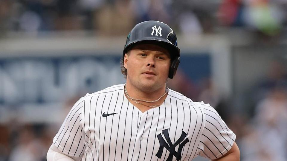 Yankees Luke Voit rounds the bases pinstripes