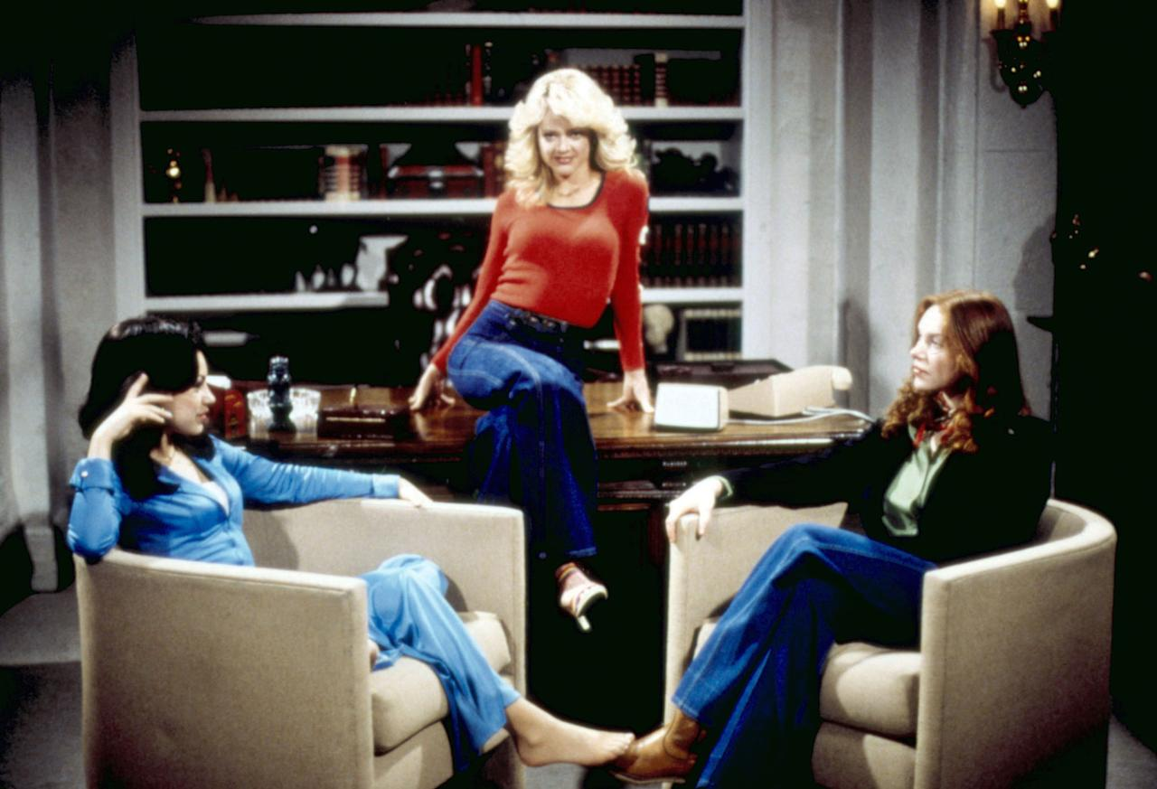 """Mila Kunis, Lisa Robin Kelly, and Laura Prepon in """"That '70s Show."""""""