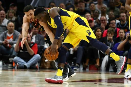 Victor Oladipo (R) of the Indiana Pacers battles for the ball with Larry Nance Jr. of the Cleveland Cavaliers