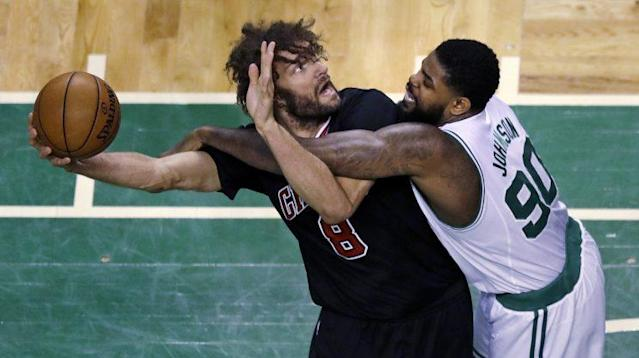 Robin Lopez holds the Celtics at arm's length. (AP)