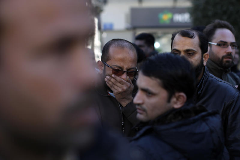 A mourner reacts after a prayer for Shehzad Luqman, a Pakistani immigrant who was killed on Thursday after being stabbed by suspected extreme rightists, during a ceremony in front of city hall in Athens on Saturday, Jan. 19 2013. An estimated 3,000 people marched through central Athens in protest at a spate of anti-immigrant attacks that turned fatal Thursday when a 27-year-old Pakistani immigrant was stabbed by suspected extreme rightists. (AP Photo/Kostas Tsironis)