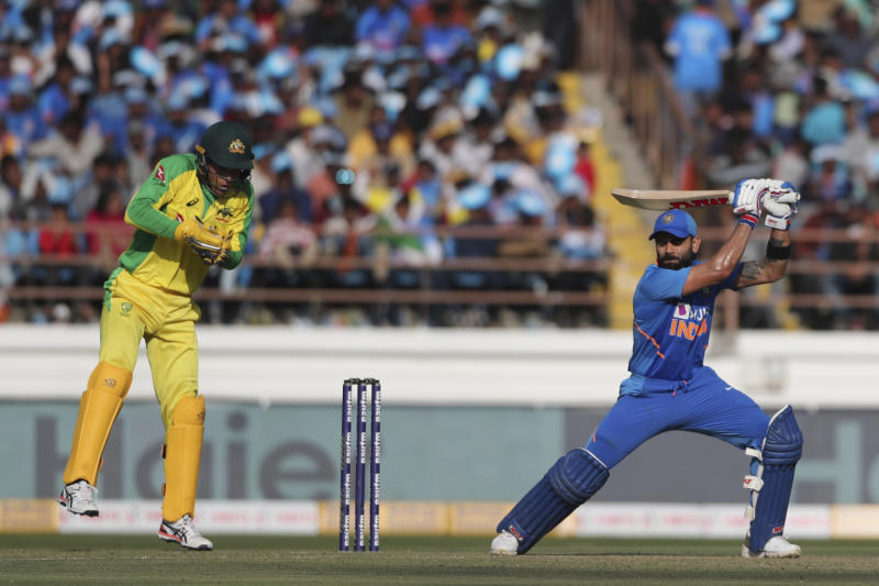 Indian cricket captain Virat Kohli plays a shot during the second one-day international cricket match between India and Australia in Rajkot, India, Friday, Jan. 17, 2020. (AP Photo/Ajit Solanki)
