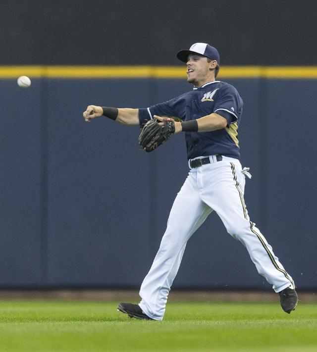 Milwaukee Brewers' Scooter Gennett makes a throw to second against the Kansas City Royals during the second inning of an exhibition baseball game Saturday, March 29, 2014, in Milwaukee. (AP Photo/Tom Lynn)