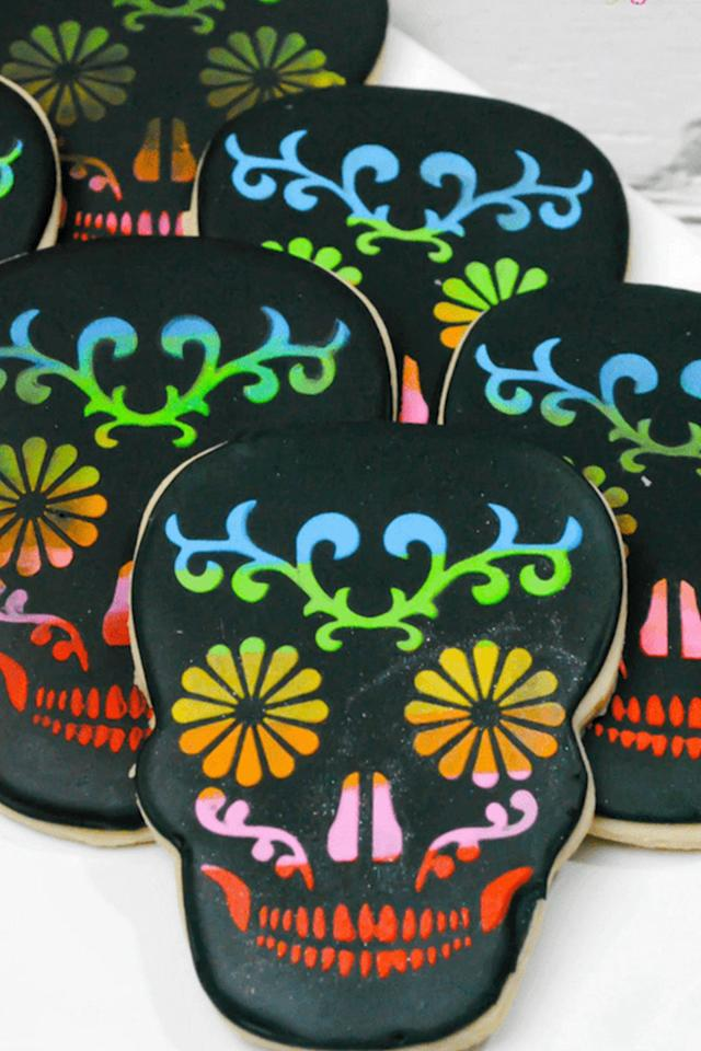 "<p>Scare and impress guests at the same time with these colorful skull cookies at <a rel=""nofollow"" href=""https://www.womansday.com/home/crafts-projects/g2488/simple-halloween-crafts/"">your next Halloween party.</a></p><p><strong>Get the recipe at <a rel=""nofollow"" href=""https://sugarspiceandglitter.com/sugar-skull-cookies/"">Sugar Spice and Glitter. </a></strong><br></p>"