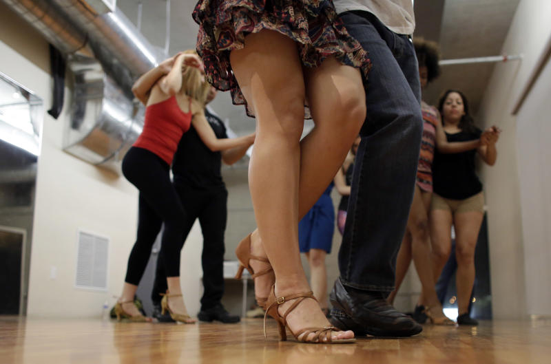 In this Monday, April 21, 2014 photo, dancers practice their moves during a Brazilian zouk dance class at the VK Dance Studio in North Miami Beach, Fla. Zouk dance and music, born in the French Caribbean, adopted in Brazil and spread through Latin America and Europe, is now taking root in the United States. (AP Photo/Lynne Sladky)